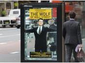Loup Wall Street: JCDecaux place vrais billets 100$ dans affiches